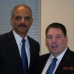 US Attorney General Eric Holder and ESFLEA Pacific/Far East region director, DEA SSA Glenn Moore during a meeting in San Francisco.